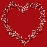 Vector floral frame in the shape of hearts on a red background Stock Photos