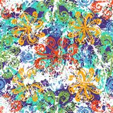 Ethnic grunge pattern. Vector floral grunge pattern on splash and splattered watercolor paint. Bold ethnic and tribal print with flowers in bright color on hand Royalty Free Stock Photo