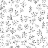 Vector floral pattern in doodle style with flowers and leaves.   Royalty Free Stock Photo
