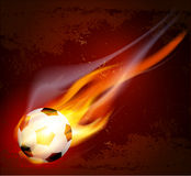 Vector flying flaming soccer ball. The Vector flying flaming soccer ball on a brown background Royalty Free Stock Images
