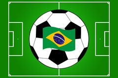 Vector of football field and ball with flag of Brazil royalty free stock image