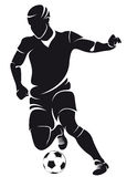 Vector football (soccer) player silhouette. With ball isolated Stock Photography
