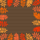 Vector frame of autumn leaves on wooden background. Royalty Free Stock Photo