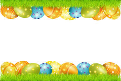 Vector frame of Easter eggs and green grass Royalty Free Stock Photo