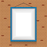 Vector frame for paintings on the brick wall. Royalty Free Stock Photography