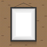 Vector frame for paintings on the brick wall. Stock Photography