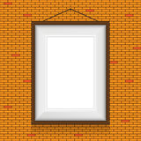 Vector frame for paintings on the brick wall. Stock Image