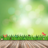 Vector fresh spring grass with green bokeh and sunlight and wood floor Royalty Free Stock Photo
