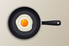 Vector fried egg on a black pan. Realistic icon. stock illustration