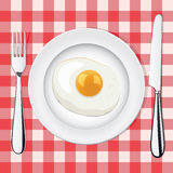 vector fried egg on a plate whith fork and knife Stock Photo