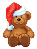 Vector of fun brown bear in red Santas hat Royalty Free Stock Photos