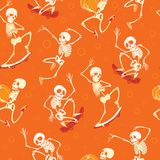 Vector fun orange dancing and skateboarding skeletons Haloween repeat pattern background. Great for spooky fun party. Themed fabric, gifts, giftwrap. Textile Royalty Free Stock Photography