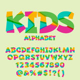 Vector funny set of letters, numbers and symbols. Vector bright cutted set of alphabet letters, digit numbers and punctuation symbols Stock Photos