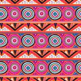 Vector geometric ethnic pattern with circles, triangles. Stripes, lines and mandalas. Tribal background in bright pink colors for spring summer fashion. Bold royalty free illustration