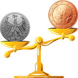 Vector German mark versus the euro. Concept of an old German coin mark and coin euro on the gold scales Stock Images