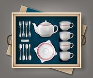 Set of kitchenware. Vector gift set of white porcelain set for tea or coffee and cutlery set in a case Royalty Free Stock Image