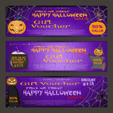 Vector gift voucher to a Halloween sale on the gradient lilac background with cracked texture. Stock Photography