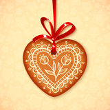 Vector gingerbread heart on red ribbon Stock Photo