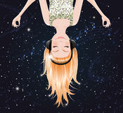 Vector girl listening to music of space. eps10. Vector trendy girl upside down is meditating and listening to music of space Royalty Free Stock Photo