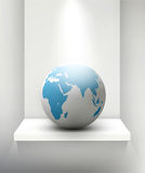 Vector globe standing on a shelf. Element for design and busines Stock Photos