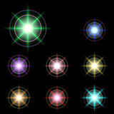 Vector glowing lights, stars and sparkles 44 Stock Image