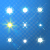 Vector glowing sun light sparks on blue background. Set of vector glowing sun light sparks on blue transparent background Stock Image