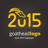 2015 vector goat logotype isolated on dark. Key ideas is 2015, goat, calendarr, xmas, new year, celebrate, gifts. Concept for corporate identity and branding Royalty Free Stock Image