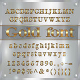 Vector gold coated alphabet letters, digits and punctuation on silver background Stock Images