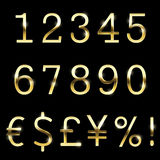 Vector gold font set currency, numbers and special symbols. Stock Photography