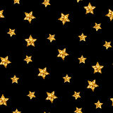Vector gold glitter stars seamless pattern on black background Royalty Free Stock Photos