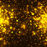Vector gold glowing light glitter background. Chrisrmas golden magic lights background Stock Photos