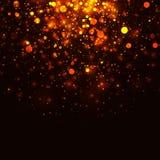 Vector gold glowing light glitter background. Christmas magic lights background. Vector gold glowing light glitter background. Christmas golden magic lights Stock Photos