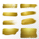 Vector gold paint smear stroke stain set. Stock Images