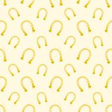 Vector gold seamless pattern of lucky horse shoes Stock Photos