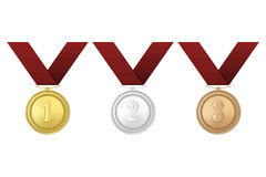 Vector gold, silver and bronze award medals with red ribbons set  on white background. The first, second, third Stock Photos