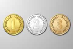 Vector gold, silver and bronze award medals set on gray background. The first, second, third prizes. Gold, silver and bronze award medals set on gray background Stock Image