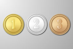 Vector gold, silver and bronze award medals set on gray background. The first, second, third prizes. Gold, silver and bronze award medals set on gray background Royalty Free Stock Images