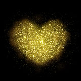 Vector gold sparkling heart of glittering shining particles. Royalty Free Stock Images