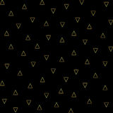 Vector gold triangles outline seamless pattern on the black background. Royalty Free Stock Image