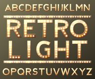 Vector golden alphabet with bulb lamps. Vector Stock Photography