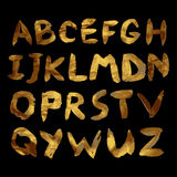 Vector golden alphabet. Unique brushed font. With golden glitter Royalty Free Stock Image