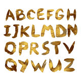 Vector golden alphabet. Unique brushed font. With golden glitter Royalty Free Stock Photography