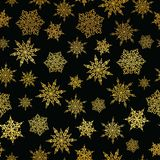 Vector golden and black snowflakes seamless repeat pattern background. Great for winter holiday fabric, giftwrap. Packaging, covers, invitations. Surface Stock Photo