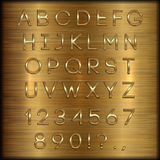 Vector golden coated alphabet letters, digits and punctuation on copper brushed background Stock Photo