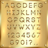 Vector golden coated alphabet letters, digits and punctuation on gold background Royalty Free Stock Photography