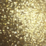 Vector golden glitter background. Template for cards, backdrops, invitations and posters Stock Images