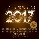 Vector golden glitter Happy New Year 2017 greeting card. With set of letters, symbols and numbers. File contains graphic styles Stock Photography