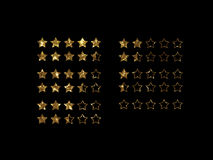 Vector golden glitter online shopping review feedback five star. The vector golden glitter of Online shopping review feedback five star rate icon set on black Stock Images