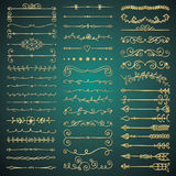 Vector Golden Glossy Hand Drawn Dividers, Arrows. Set of Hand Drawn Golden Glossy Royal Design Elements. Decorative Flourish Dividers, Arrows, Swirls, Scrolls Royalty Free Stock Photo