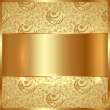 Vector golden metal plate with ethnic ornamental background Stock Photo